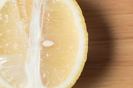 closeup sliced lemon fruit on a wooden block Stock Photo