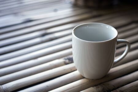White cup on a wooden background