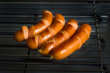 grilled sausage on a grill grate