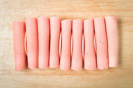 rolled ham arrange on wood block