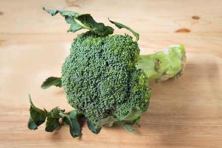 fresh broccoli on a wooden block