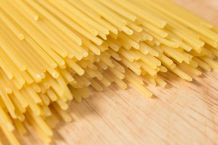pile of raw spaghett on a wooden block