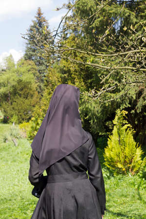 catholic nuns: A nun in the garden