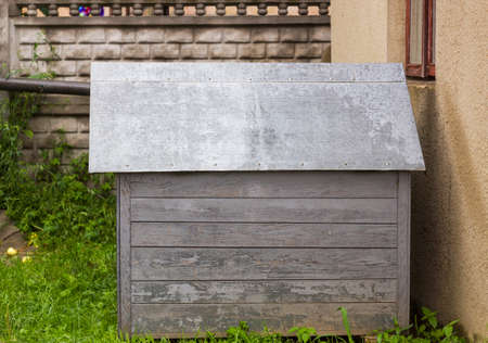 doghouse: Old wooden dog house for dog with tin roof in yard