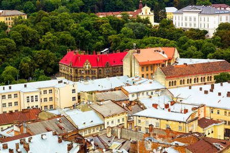 lvov: Top view of colorful roofs and houses old European city Lvov in Ukraine in summer day Stock Photo