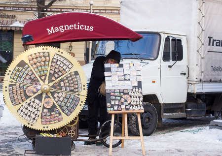 Lvov, Ukraine - 06.01.2017:  Unusual kiosk in form of clockwork gears with souvenir magnets for sale