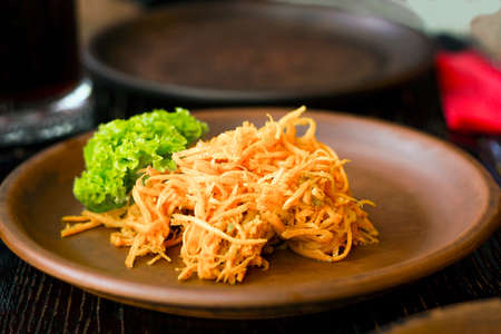 Korean carrot with green leaf lettuce on clay plate, selective focus