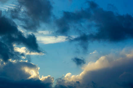Thunderclouds with clouds on blue sky background Stock Photo