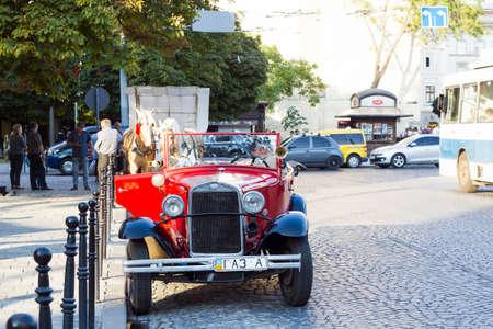 Lviv, Ukraine - July 22, 2017: Old retro Soviet red car GAZ 1936 stands on road. Vintage car cabriolet on city street, front view Redakční