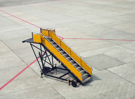 Ladder of plane. Empty gangway on aerodrome Banco de Imagens