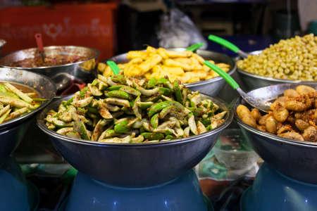 Thai street food spicy fruit, salad at street market