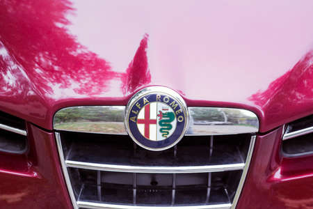Lviv, Ukraine - 08 October 2017: Close-up view of logo on hood car Alfa Romeo Editorial