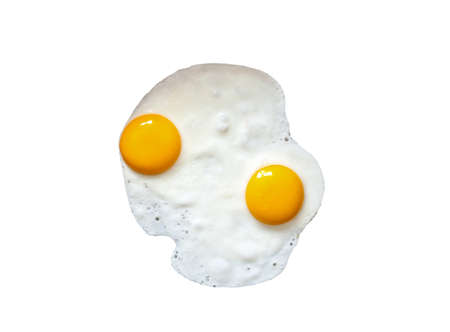 Two fried eggs cooked for early breakfast. Chicken fry egg with yellow yolk isolated on white background