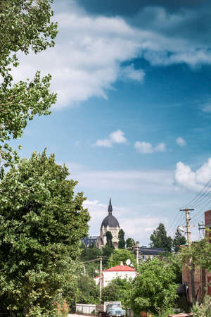 Lviv summer cityscape and christian Church of ascension of lord by blue sky Фото со стока - 126766991