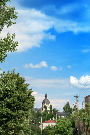 Lviv summer cityscape and christian Church of ascension of lord by blue sky Редакционное