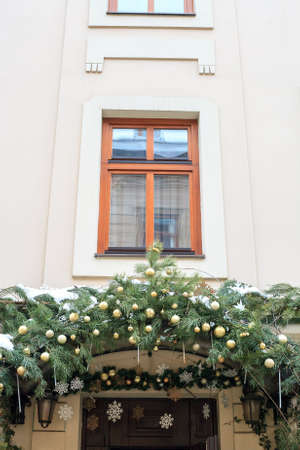 Wooden door visor decorated fir branches, balls and snowflakes. Christmas holidays decor on gift shop