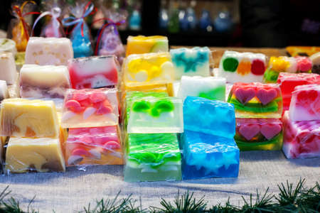 Pieces of multicolored handmade soap sold сhristmas market