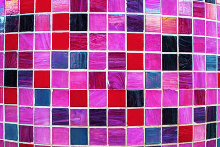 Colorful glossy mosaic texture. Background of tiles in pink and purple tones