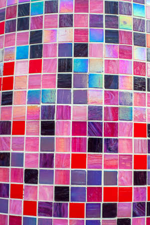 Multicolor mosaic texture. Glossy background of tiles in pink and purple tones 写真素材