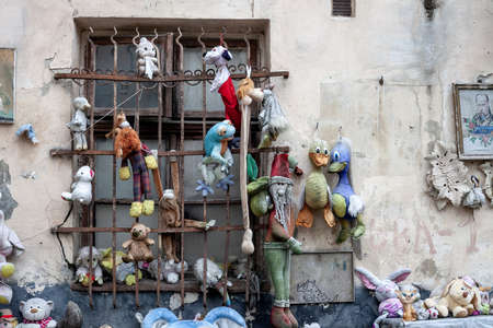 Ukraine, Lviv - 01 March 2020: Window with metal bars and hanging old toys