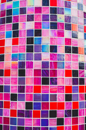 Multicolored gloss mosaic texture. Backdrop of tiles in pink and purple tones
