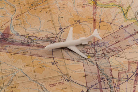 Toy airplane on 1950 s vintage government aviation chart