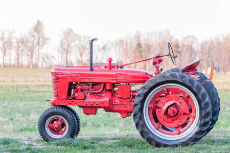 antique: Antique Tractor at Sunset Stock Photo