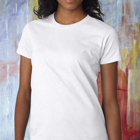 Woman wearing a white t-shirt standing in front of a colorful background Standard-Bild