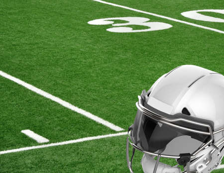 Close-up view of football helmet lying on the field near the 30 yard line in an American stadium