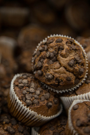 several: Several chocolate muffins with chocolate chips close up