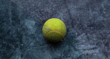 Old shabby and dusty green tennis ball Zdjęcie Seryjne