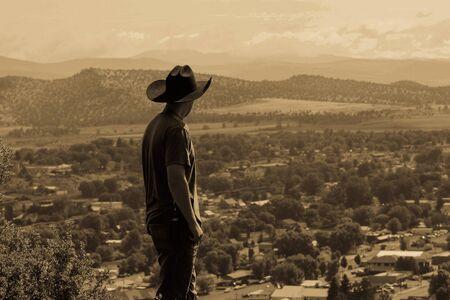 Cowboy Overlooking Town
