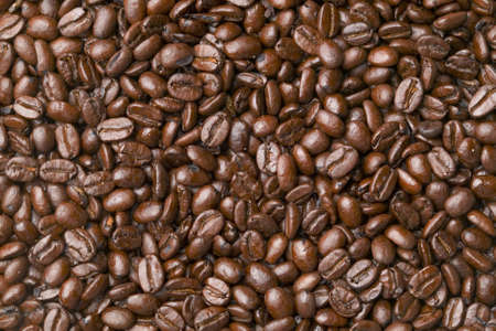 Background material of dark roasted whole coffee beans.