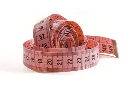 Pink measure tape twisted Stock Photo