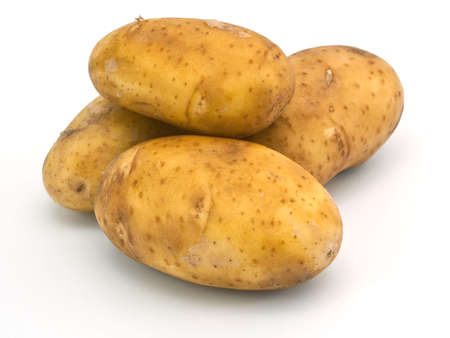 Isolated four yellow potatoes on white background Stock Photo