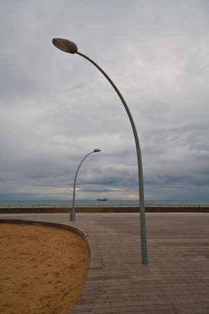 Two street lamp on Tel Aviv embankment at evening