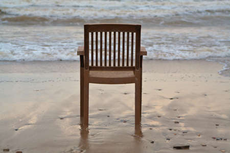A lonely plastic chair on the beach photo