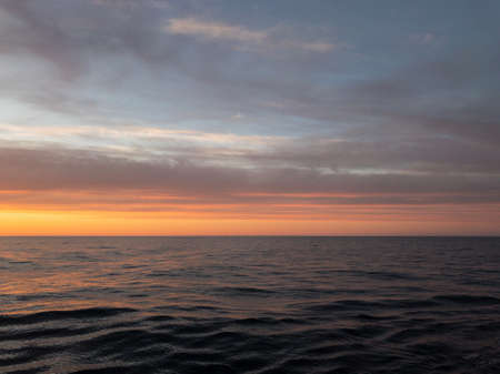 magnificent sunset in the sea shot from the deck of the ship in the evening