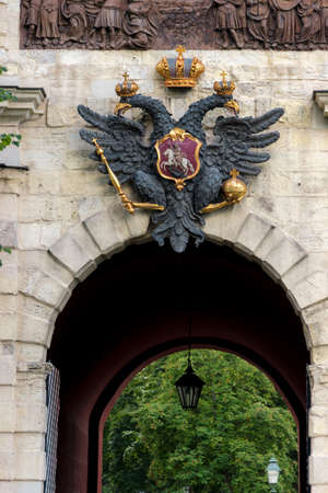 Coat of arms of Russian empire above the gates of Peter and Paul fortress Stock Photo