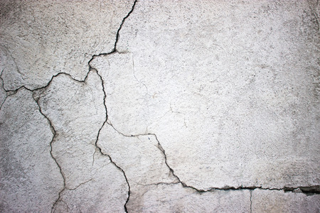 Texture gray concrete wall cracks cement surface as background