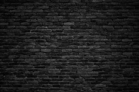 sombere achtergrond, zwarte bakstenen muur van donkere steen textuur Stockfoto