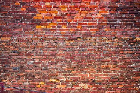 red brick wall, urban exterior weathered surface as background