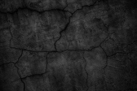 gloomy concrete wall with cracks. destroyed black slab of slab Stock fotó