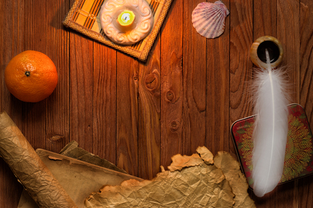 paper sheet: Vintage still life with feather, old paper and burning candle on canvas background