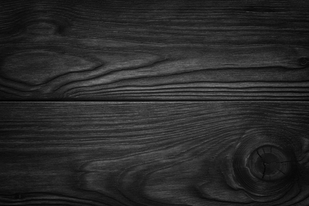 white wood floor: black wooden abstract background with light and scratches, dark wood texture