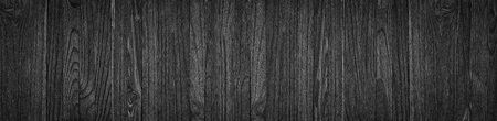 Black wood surface texture as a background, wide panorama