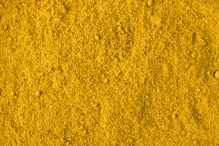 texture of curry powder close-up, spice or seasoning as background