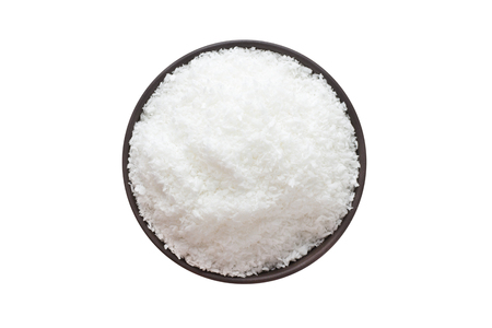 Coconut powder in bowl, top view, isolated on a white background. organic spice