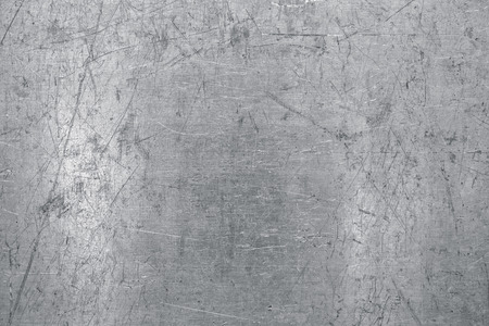 Worn steel sheet background, light metal texture with scratches and dents Foto de archivo