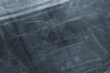 Dark titanium plate, gray metal texture as background